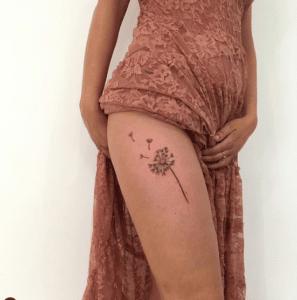 Tatuaż dmuchawiec na nodze